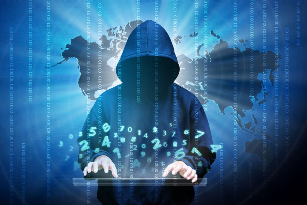 A computer hacker wearing a blue hoodie trying to access our secured and safe invoicing software